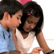 Asian Siblings Using Wireless Tablet — Stock Video