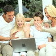 Young Family Using Laptop for Webchat — Stock Video #23262100