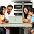 Young Ethnic Family with Laptop in Kitchen — Stock Video #23262204