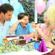 Young Caucasian Family Enjoying Birthday Cake — Stock Video #23262272