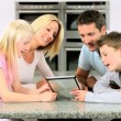 Young Family with Wireless Tablet in Kitchen — Stock Video #23262370