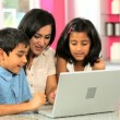 Attractive Asian Mother & Children Using Laptop - Stock Photo