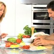 Young Couple Preparing Healthy Lunch - Stock Photo
