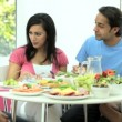 Young Ethnic Family Enjoying a Healthy Meal — Stock Video #23262786