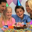 Young Caucasian Children Enjoying Birthday Celebrations - Stock Photo