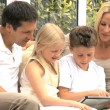 Young Caucasian Family Having Fun with Wireless Tablet — Stock Video