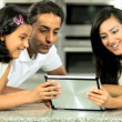 Young Asian Family Using Wireless Tablet — Stock Video #23263122