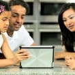 Asian Family Playing on Wireless Tablet — Stock Video #23263170