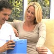 Stock Video: Young CaucasiHusband Opening Birthday Gift