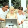 Young Caucasian Family with Laptop Computer — Stock Video