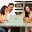 Stock Video: Asian Family Using Online Video Chat with Relatives