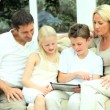 Young Caucasian Family Having Fun with Wireless Tablet — Stock Video #23264226