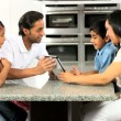 Asian Family Using Online Video Chat with Relatives - Foto Stock