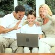 Young Caucasian Family Using Online Webchat — Stock Video #23264340