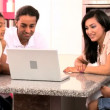 Young Asian Family Using Laptop in Kitchen — 图库视频影像