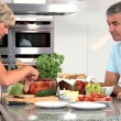 Stock Video: Attractive Couple Preparing Healthy Lunch