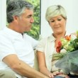 Stock Video: Pretty Middle Aged Lady with Anniversary Bouquet
