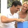 Stock Video: Attractive Husband Opening Birthday Gift