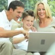 Young Family Using Laptop for Webchat — Stock Video #23264818