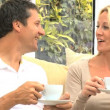 Caucasian Couple Drinking Coffee at Home - Stock Photo