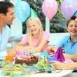 Young Caucasian Boy Blowing Out Birthday Candles - Stock Photo