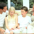 Young Caucasian Family Together at Home - Stock Photo