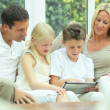Young Caucasian Family Using Wireless Tablet — Stock Video #23265250