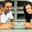 Stock Video: Young Asian Family Having Fun with Wireless Tablet