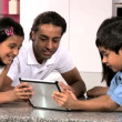 Young Asian Family Using Wireless Tablet — Stock Video
