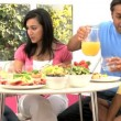 Young Ethnic Family Eating Healthy Lunch Together — Stock Video