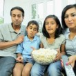 Young Ethnic Family Watching TV with Popcorn — Stock Video