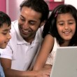 Young Asian Father & Children Using Laptop in Kitchen — Stock Video