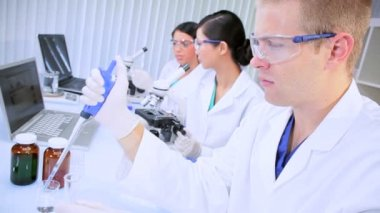Three Research Assistants Working in Medical Laboratory — Stock Video