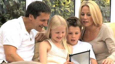 Young Family with Wireless Tablet in Home Setting — Stock Video
