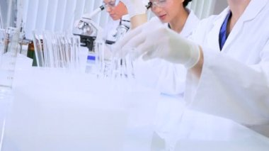 Three Junior Doctors Working in Hospital Laboratory — Stock Video