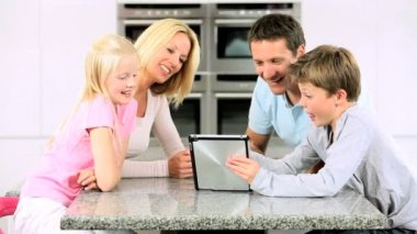 Young Caucasian Family Using Wireless Tablet — Wideo stockowe