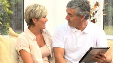 Middle Aged Couple Happy with Their Financial Planning — Stock Video