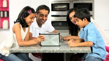 Young Ethnic Family with Wireless Tablet in Kitchen — Stock Video