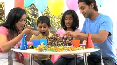 Young Asian Family Sharing Party Birthday Cake — Stock Video #23261840