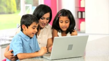 Attractive Asian Mother & Children Using Laptop — Stock Video