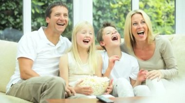 Young Family Watching Movie Together with Popcorn — Stock Video