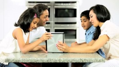 Asian Family Using Wireless Tablet for Online Video Chat — Stock Video