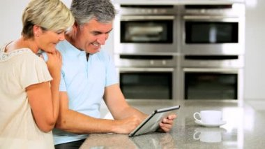 Mature Couple with Wireless Tablet Having Success Online — Stock Video