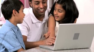 Young Asian Father & Children in Kitchen with Laptop — Stock Video