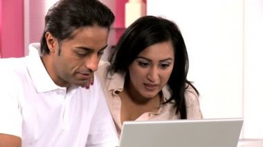 Ethnic Couple with Laptop Having Online Success — Stock Video