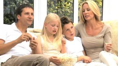 Attractive Family Enjoying TV & Popcorn — Stock Video