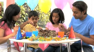 Young Ethnic Family Enjoying Birthday Cake — Stock Video