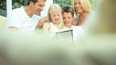 Young Family Using Wireless Tablet for Webchat — Stock Video