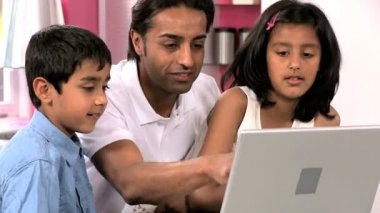 Young Asian Father & Children Using Laptop — Stock Video