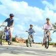 Healthy Caucasian Family Cycling Together - Stock Photo